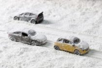 Car on the road with heavy snow.